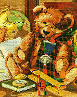 Heirloom Teddy Bear with glasses, war medal, and tartan scarf, is the focal point in this attic of treasures. This needlepoint design is rich in color and imagery and is the perfect design for bear or aviation lovers.
