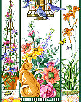 This golden cat is enjoying watching the birds feeding, and the butterflies and flowers all around.