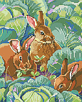 Three bunny's nibbling clover peek out from the cabbage patch in this realistic and elegant Bunny's Cabbage Garden design by designer Linda Gillum.