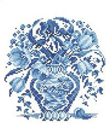This lovely floral piece is worked in shades of delft blue.