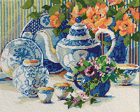 Steeping in savored charm, this blue and white Needlepoint still life seems to come alive with the bright peach begonias and pretty purple pansies amid a beautiful china tea set. Stitch with memories of sharing tea with a friend and re-living the good times that always brew at Tea Time. This needlepoint piece is designed by Nancy Rossi. Each kit contains 12-mesh needlepoint printed canvas, wool yarn, needle, chart and instructions in English, French, Spanish and German.
