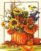 Vibrant and festive, this Counted Cross Stitch piece will compliment any decor during the fall season.