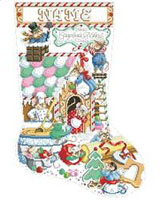 This stocking shows these delightful mice decorating their gingerbread house for the holiday season.