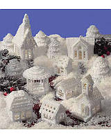What says Christmas better than a village covered in glistening snow? Easy instructions include a complete grouping of charming houses, a gazebo, trees and a church to complete your frosty holiday village. All designed using white 7-mesh plastic canvas. This classic pattern uses a few easy-to-do stitches using white worsted weight yarn.