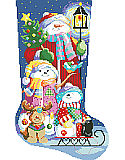 Winter Fun Stocking - PDF: Our cheerful snow family is glowing in the light of a candlelit lantern on a cold dark winters evening.