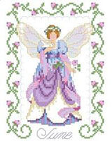 Peace is reflected in our June fairy. A white dove rests on one hand and in the other; she holds a pink rose, the flower of the month of June. One in a series of twelve faeries.