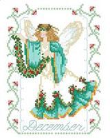 Our December Birthday Fairy is holding a colorful garland of Holly and evergreens. She's a lovely reminder of the December birthdays. One in a series of twelve faeries.