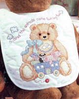 A bib set to go with the God Bless Baby crib cover.