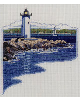 White Lighthouse on the rocky shore