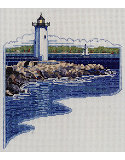 White Lighthouse: White Lighthouse on the rocky shore